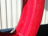 Red flip alloy wheel (close up)